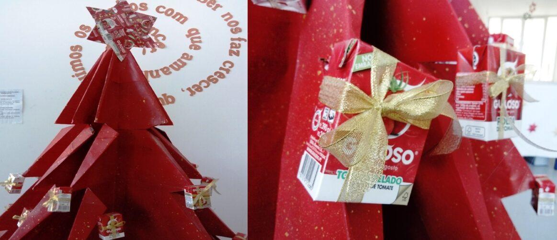 5 - Pormenores da estrela construída com a técnica de dobragem com seis embalagens Guloso e dos enfeites da árvore ( embalagens Guloso com o símbolo FSC)   ornamentados com fita dourada simbolizando  presentes.