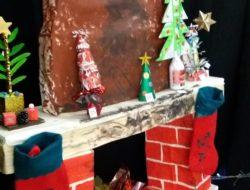 Decoração do átrio: lareira feita com caixotes, onde se vê as árvores