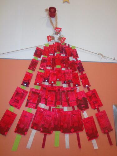 Pormenor: Estrela de Natal com embalagens Guloso